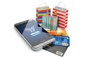 colorful shopping bags, a phone indicating a shopping cart and three credit cards to help you shop online